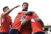 Jack Marriott of Luton Town (not seen) is mobbed by team mates after scoring the equalizing goal during the Sky Bet League 2 match between Luton Town and Doncaster Rovers at Kenilworth Road, Luton, England on 24 September 2016. Photo by Liam Smith.