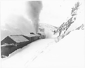 D&amp;RGW rotary snowplow #OY at work on snowdrift on Windy Point.<br /> D&amp;RGW  Windy Point, CO  Taken by Norwood, John B. - 1/1952