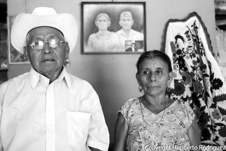 A Native nahuatl couple poses for a photograph in their home in Jaltocan, in northern state of Hidalgo, November 1, 2004. Photo by Heriberto Rodriguez *** Local Caption *** ..