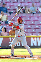 Jose Trevino #33 of the Spokane Indians bats against the Salem-Keizer Volcanoes at Volcanoes Stadium on July 26, 2014 in Keizer, Oregon. Spokane defeated Salem-Keizer, 4-1. (Larry Goren/Four Seam Images)