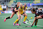 The Hague, Netherlands, June 05: Jane Claxton #18 of Australia in action during the field hockey group match (Women - Group A) between Belgium and Australia on June 5, 2014 during the World Cup 2014 at Kyocera Stadium in The Hague, Netherlands. Final score 2:3 (1:1) (Photo by Dirk Markgraf / www.265-images.com) *** Local caption *** (L-R) Stephanie Vanden Borre #22 of Belgium, Jane Claxton #18 of Australia, Lieselotte Van Lindt #9 of Belgium