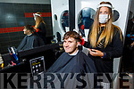 Marcus Prenderville from Tralee getting a hair cut from Ciara Lawlor in Joe O'Brien Barbers, Ashe Street on Monday as he re opens his shop.