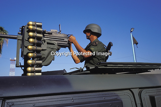 PSPOLIC27210.Police. Nuevo Loredo across the border from Loredo in South Texas. Mexican police and military marched during Independance Day. Soldier operating a machine gun. Weapon, bullets, soldier. 9/99..©Per-Anders Pettersson / iAfrika Photos