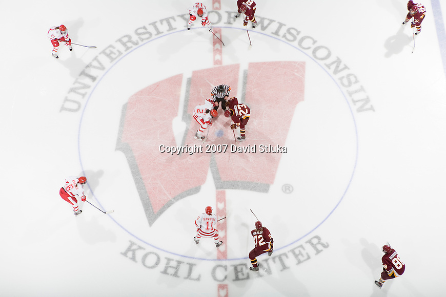 MADISON, WI - DECEMBER 1: An overhead view of a faceoff during the Wisconsin Badgers game against the Minnesota Duluth Bulldogs at the Kohl Center on December 1, 2007, in Madison, Wisconsin. The Bulldogs beat the Badgers 3-2. (Photo by David Stluka)