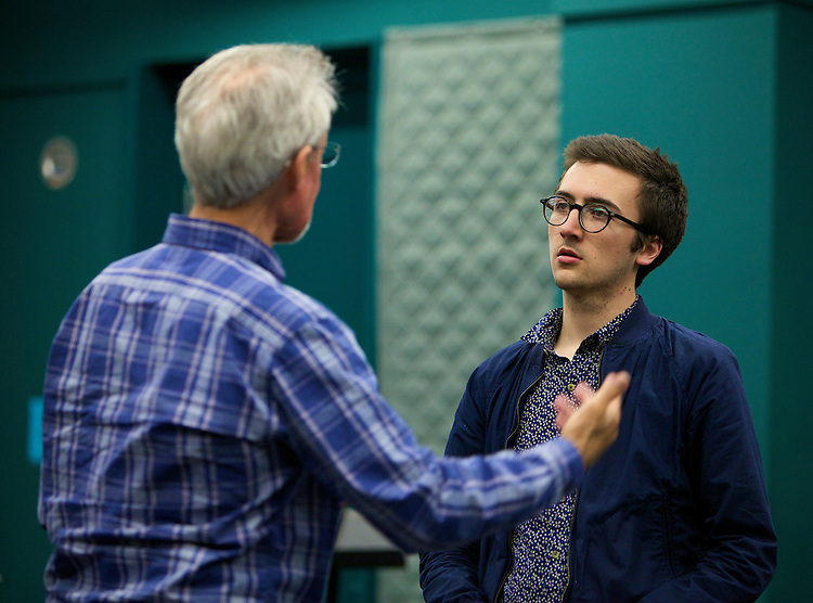 John Jenkins, director (left), gives direction to Sam Kotansky, playing the part of Eli as they rehearse Jared Hecht's play VIDEO GALAXY Tuesday, April 28, 2015, in The Theatre School building on DePaul's Lincoln Park campus. VIDEO GALAXY was selected for full production in the New Playwrights Series, and will run on The Theatre School's Fullerton Stage May 22-30, 2015. (DePaul University/Jeff Carrion)