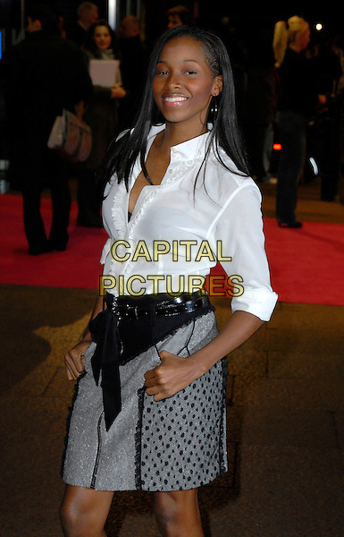 "JAMELIA.Attends the UK Premiere of ""Music & Lyrics"",.Odeon Leicester Square, .London, England, February 5th 2006..half length white shirt grey and black skirt belt hands in pockets.CAP/CAN.©Can Nguyen/Capital Pictures"