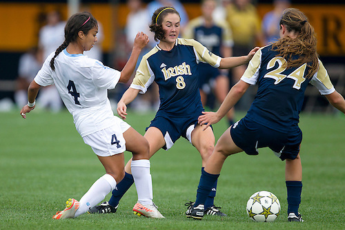 September 02, 2012:  North Carolina forward Bianca Gray (4) and Notre Dame players Elizabeth Tucker (8) and Katie Naughton (24) battle for the loose ball during NCAA Soccer match between the Notre Dame Fighting Irish and the North Carolina Tar Heels at Alumni Stadium in South Bend, Indiana.  North Carolina defeated Notre Dame 1-0.