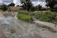 Raw sewage flows in the streets of a Harare suburb. Open sewers like this are largely responsible for the cholera epidemic that has struck the country.