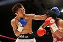 (L-R) Akira Yaegashi (JPN), Pornsawan Porpramook (THA), OCTOBER 24, 2011 - Boxing : Akira Yaegashi of Japan hits Pornsawan Porpramook of Thailand during the eighth round of the WBA minimumweight title bout at Korakuen Hall in Tokyo, Japan. (Photo by Mikio Nakai/AFLO)