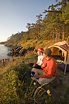 Sea kayak camping, couple, Strawberry Island, San Juan Islands, Puget Sound, Salish Sea, Washington State, U.S.A., Washington State Department of Natural Resources, Cypress Island Natural Resources Conservation Area, model released,.