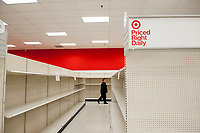 A man walks past aisles of empty shelves during these days of the COVID-19 pandemic, at the Target store in Alexandria, Va., Monday, March16, 2020. Credit: Rod Lamkey / CNP/AdMedia