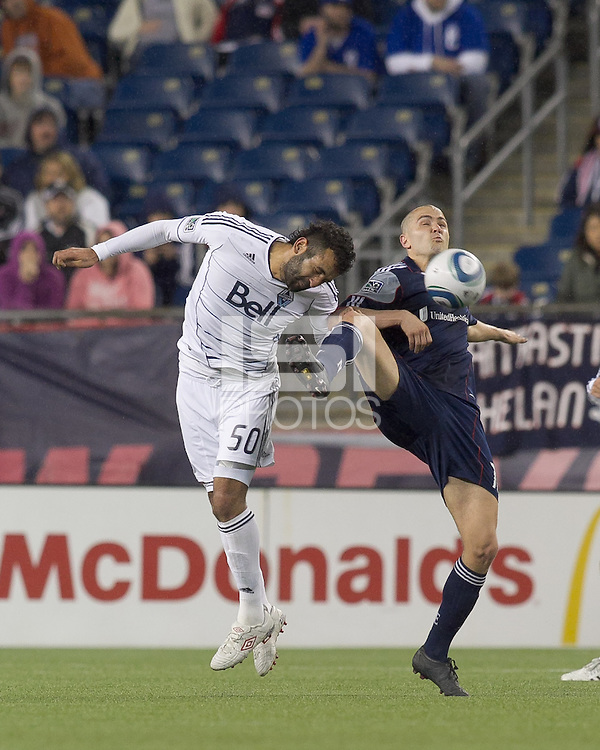 Vancouver Whitecaps FC defender Mouloud Akloul (50) and New England Revolution forward Rajko Lekic (10) battle for head ball. In a Major League Soccer (MLS) match, the New England Revolution defeated the Vancouver Whitecaps FC, 1-0, at Gillette Stadium on May14, 2011.