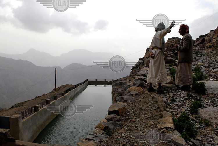 Men discuss a World Bank funded water project in the mountains west of the capital Sana'a..