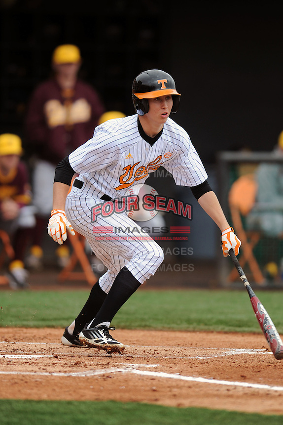 Tennessee Volunteers shortstop A.J. Simcox #10 swings at a pitch during a game against  the Arizona State Sun Devils at Lindsey Nelson Stadium on February 23, 2013 in Knoxville, Tennessee. The Volunteers won 11-2.(Tony Farlow/Four Seam Images).