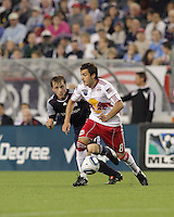 New York Red Bulls midfielder Sinisa Ubiparipovic (8) moves the ball as New England Revolution defender Seth Sinovic (27) pressures. The New England Revolution defeated the New York Red Bulls, 3-2, at Gillette Stadium on May 29, 2010.