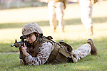 October 22, 2014. Camp LeJeune, North Carolina.<br />  LCpl. Karla Cardenas, right, aims a M4 rifle during patrol training for the 3rd Platoon of the Ground Combat Element Integrated Task Force. Marines in 3rd Platoon of the GCEITF are all considered provisional infantrymen as they have not been to the School of Infantry (SOI) previous to volunteering for the GCEITF.<br />  The Ground Combat Element Integrated Task Force is a battalion level unit created in an effort to assess Marines in a series of physical and medical tests to establish baseline standards as the Corps analyze the best way to possibly integrate female Marines into combat arms occupational specialities, such as infantry personnel, for which they were previously not eligible. The unit will be comprised of approx. 650 Marines in total, with about 400 of those being volunteers, both male and female. <br />  Jeremy M. Lange for the Wall Street Journal<br /> COED