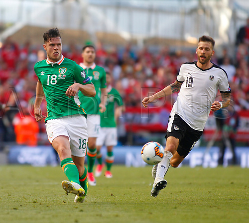 June 11th 2017, Dublin, Republic Ireland; 2018 World Cup qualifier, Republic of Ireland versus Austria; Kevin Long (Republic of Ireland) plays the ball away under pressure from Guido Burgstaller