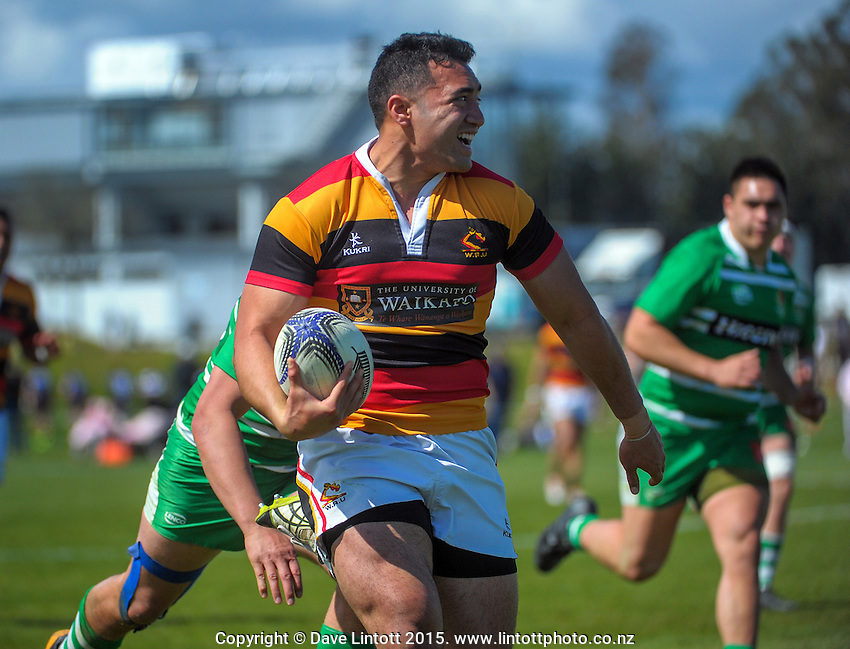 Waikato's Amanaki Savieti heads for the tryline during the Jock Hobbs Memorial Under-19 Provincial rugby union tournament match between Manawatu (green) and Waikato (red gold and black) at Owen Delaney Park, Taupo, New Zealand on Sunday, 27 September 2015. Photo: Dave Lintott / lintottphoto.co.nz