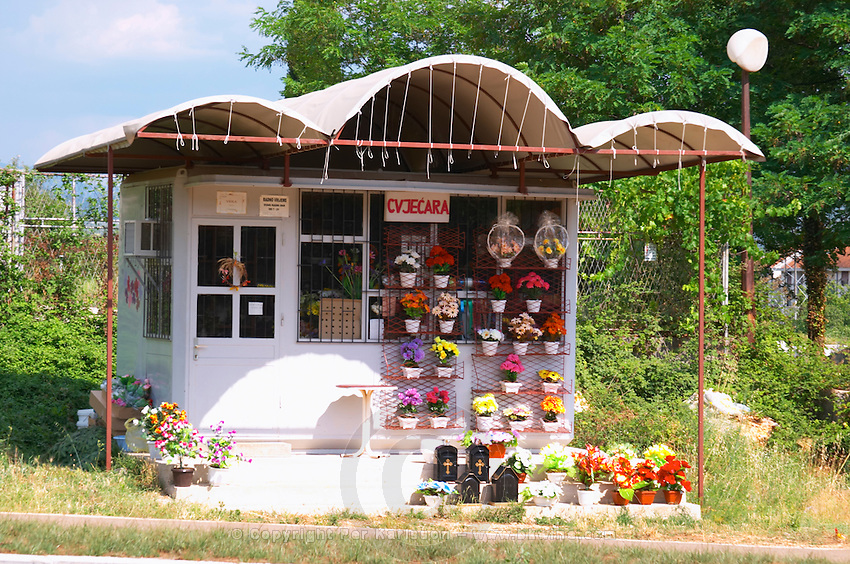 A small shop selling flowers next to the church yard. Trebinje. Republika Srpska. Bosnia Herzegovina, Europe.