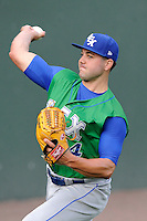Starting pitcher Jake Junis (24) of the Lexington Legends warms up before a game against the Greenville Drive on Wednesday, June 4, 2014, at Fluor Field at the West End in Greenville, South Carolina. Lexington won, 9-3 and Junis got the win. (Tom Priddy/Four Seam Images)