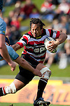 Tana Umaga pushes off the Northland tackler as he makes a break that leads to the Fritz Lee try. ITM Cup rugby game between Counties Manukau Steelers and Northland, played at Bayer Growers Stadium, Pukekohe, on Sunday September 26th 2010..The Counties Manukau Steelers won 40 - 24 after leading 27 - 7 at halftime.