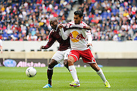 Omar Cummings (14) of the Colorado Rapids and Wilman Conde (2) of the New York Red Bulls balle for the ball. The New York Red Bulls defeated the Colorado Rapids 4-1 during a Major League Soccer (MLS) match at Red Bull Arena in Harrison, NJ, on March 25, 2012.