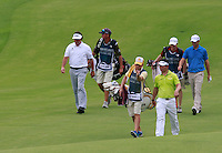Y.E.Yang (KOR), Phil Mickelson (USA) and Padraig Harrington (IRL) walk down the 3rd hole during Friday's resumed Round 2 of the 2011 Barclays Singapore Open, Singapore, 11th November 2011 (Photo Eoin Clarke/www.golffile.ie)