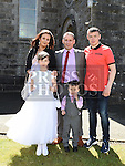 Leah Boylan who received first holy communion in the Church of the Assumption in Tullyallen pictured with her parents George and Danielle and brothers Coady and Dylan. Photo:Colin Bell/pressphotos.ie