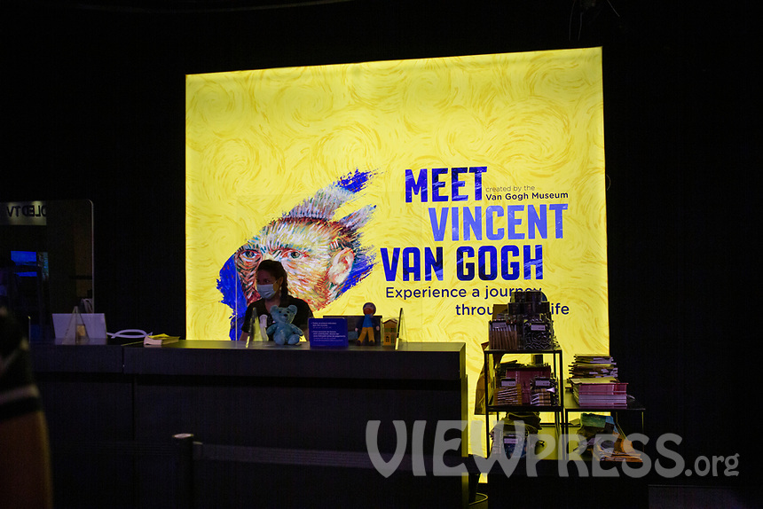 "LISBON, PORTUGAL - MAY 31: A store clerck wearing a face mask the ""Meet Vicent Van Gogh"" exhibition as the spread of the (COVID-19) continues in Lisbon, on May 31, 2020. Meet Vincent van Gogh is an interactive experience, to get to know Lisbon, through which it proposes to make Vincent's art accessible to as many people as possible.<br /> (Photo by Luis Boza/VIEWpress via Getty Images)"