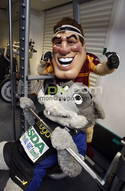 Pix : Andrew Catchpool/SWpix.com  03/04/2008. Super League Rugby League Mascots in the gym gearing up for Cardiff Millenium Magic weekend..copyright picture>>simon wilkinson>>07811 267 706>>..Rugby Superleague team mascots.Big G (Huddersfield Giants) and Wolfie (Warrington Wolves).