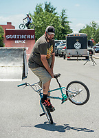 NWA Democrat-Gazette/BEN GOFF @NWABENGOFF<br /> Danny Harrison, owner of Southern BMX Stunt Show, of Little Rock performs flatland tricks Saturday, July 7, 2018, during The Natural State Criterium Series in downtown Rogers. The third annual series produced by BikeNWA began with races in downtown Bentonville Friday evening. The series concludes Sunday in downtown Springdale with the first event starting at 8:50 a.m. and the final event starting at 4:00 p.m.