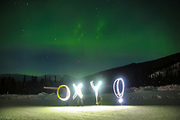"(Photo by Bo (Yinbo) Gao '18)<br /> <br /> Occidental College students Ruby Chen '19, Jingyi Ma '18, Eva Wang '17 and Liyao Wei '17 light paint the word, ""Oxy!"" as Bo Gao '18 takes their photo under the aurora borealis (northern lights) in Chena Hot Springs, Alaska, during Spring Break, March 6, 2017.<br /> <br /> (Photo by Bo (Yinbo) Gao '18)"