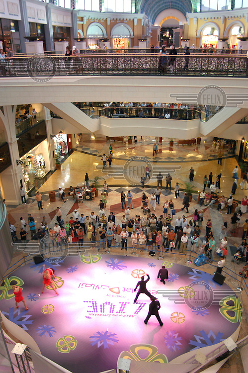 Dances perform on a stage in the MAll of the Emirates.