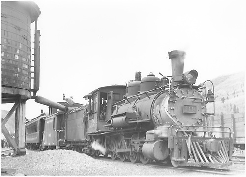 3/4 engineer's-side view of leased D&amp;RGW #319 with a northbound RGS Rocky Mountain Railroad Club excursion taking water at the Rico water tank.<br /> RGS  Rico, CO  5/31/1947