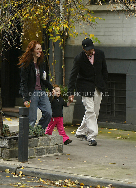 New York City, November 25 2004: Actress Julianne Moore, her daughter Liv Helen and her director husband Bart Freundlich were casual and cute as they took a Thanksgiving Day stroll around their West Village neighbourhood with freinds. Freundlich even demonstrated how to be a father and a quarterback simultaneously! ....Please byline: PHILIP VAUGHAN/ACEPIXS.com....All Celebrity Entertainment, Inc..Contact: Alecsey Boldeskul, (646) 267 6913..e-mail: info@acepixs.com