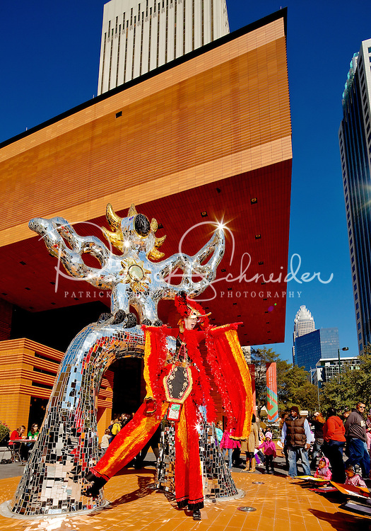 Entertainers and visitors interact beside the Firebird statue outside the Bechtler Museum. Thousands of people came downtown during the Wells Fargo Community Celebration, held October 29, 2011 in downtown Charlotte NC. The daylong festival took place in the streets, in public atriums and in downtown museums, which offered free admission all day long. Wells Fargo, which this month completed its conversion from Wachovia, picked up the bill.
