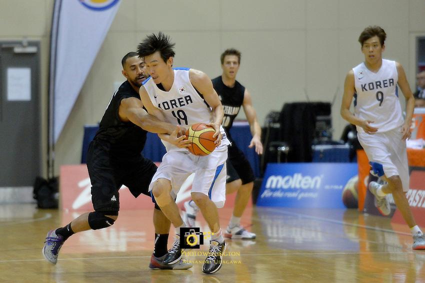 Mika Vukona and Joo Sung Choi in action during the International Basketball - Tall Blacks v South Korea at TSB Bank Arena, Wellington, New Zealand on Tuesday 15 July 2014. <br /> Photo by Masanori Udagawa. <br /> www.photowellington.photoshelter.com.