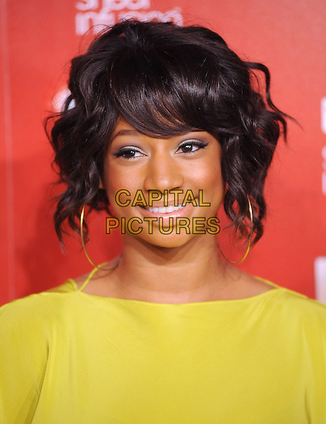 MONIQUE COLEMAN.US Weekly's Hot Hollywood Party 2009 held at Voyeur, West Hollywood, California, USA. .November 18th, 2009.headshot portrait eyeshadow blue hoop gold earrings yellow green.CAP/RKE/DVS.©DVS/RockinExposures/Capital Pictures.
