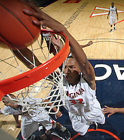 CHARLOTTESVILLE, VA- December 27: Darion Atkins #32 of the Virginia Cavaliers dunks the ball in front of Percy Woods #12 of the Maryland-Eastern Shore Hawks during the game on December 27, 2011 at the John Paul Jones Arena in Charlottesville, Va. Virginia defeated Maryland Eastern Shore 69-42.  (Photo by Andrew Shurtleff/Getty Images) *** Local Caption *** Darion Atkins;Percy Woods