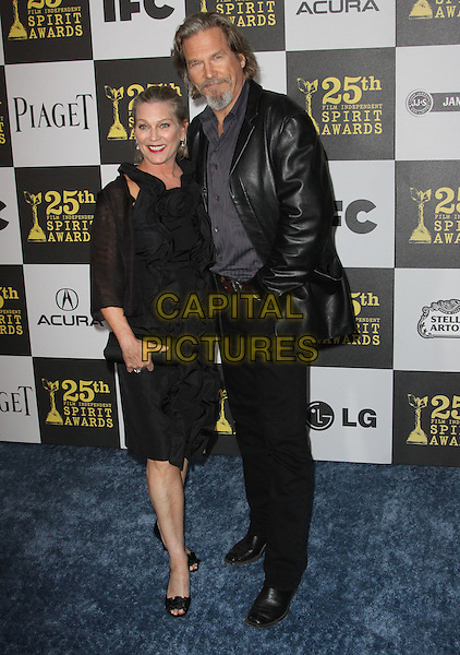 SUSAN GESTON & JEFF BRIDGES .25th Annual Film Independent Spirit Awards held At The Nokia LA Live, Los Angeles, California, USA,.March 5th, 2010 ..arrivals Indie Spirit full length ruffle ruffles dress married couple husband wife beard goatee facial hair earrings black leather grey gray shirt open toe shoes clutch bag hand in pocket pinstripe .CAP/ADM/KB.©Kevan Brooks/Admedia/Capital Pictures