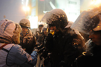 Protesters offer hot tea to the policemen to underline peaceful intentions of their protest. People try to regain trust after bloody events on Bankova street on 1st of december. Tonight the  police is expected to forcedly evacuate the streets from the protesters blocking all the government buildings. Kiev. Ukraine.