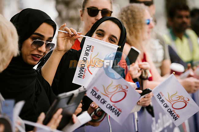Local fans cheer on the riders at the start of Stage 6 of the 10th Tour of Oman 2019, running 135.5km from Al Mouj Muscat to Matrah Corniche, Oman. 21st February 2019.<br /> Picture: ASO/P. Ballet | Cyclefile<br /> All photos usage must carry mandatory copyright credit (© Cyclefile | ASO/P. Ballet)