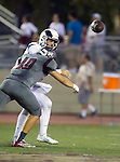 Torrance, CA 09/25/15 - Jason Kehl (El Segundo #12) and Ryan Kirkwood (Torrance #40) in action during the El Segundo - Torrance varsity football game at Zamperini Field of Torrance High School