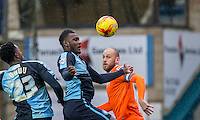 Aaron Pierre (centre) of Wycombe Wanderers in action during the Sky Bet League 2 match between Wycombe Wanderers and Luton Town at Adams Park, High Wycombe, England on 6 February 2016. Photo by Andy Rowland.