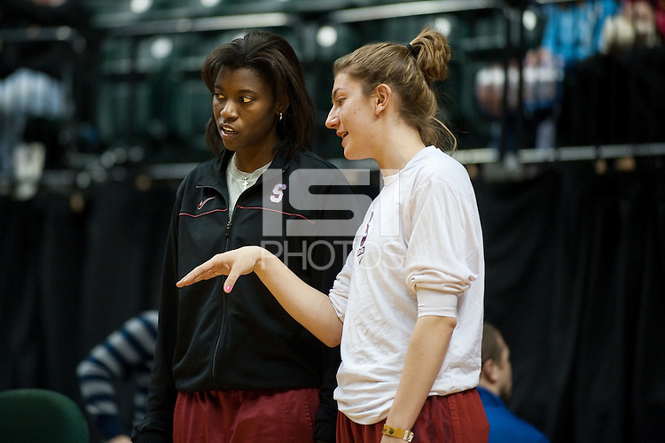 INDIANAPOLIS, IN - APRIL 2, 2011: Coach Bobbie Kelsey and Toni Kokenis during an open practice session at Conseco Fieldhouse at the NCAA Final Four in Indianapolis, IN on April 1, 2011.