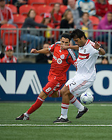 16 May 09: Chicago Fire defender Wilman Conde #22 and Pablo Vitti #8 in action at BMO Field in a game between the Chicago Fire and Toronto FC..Chicago Fire won 2-0..