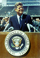 "Houston (TX) USA - 09/12/1962 - File Photo - President Kennedy speaks before a crowd of 35,000 people at Rice University in the football field. The following are excerpts from his speech. "" ...We set sail on his new sea because there is a new knowledge to be gained, and new rights to be won, and they must be won and used for the progress of all people. ...Whether it will become a force for good or ill depends on man, and only if the United States occupies a position of pre-eminence can we help decide whether this new ocean will be a sea of peace or a new terrifying theater of war. But I do say space can be explored and mastered without feeding the fires of war, without repeating the mistakes that man has made with extending his writ around this globe of ours. ...There is no strife, no prejudice, no national conflict in outer space as yet. Its conquest deserves the best of all mankind, and its opportunity for peaceful cooperation may never come again. But why, some say the Moon? Why choose this as our goal? And they may well ask, why climb the highest mountian? Why - 35 years ago - why fly the Atlantic? Why does Rice play Texas? We choose to go to the Moon, we choose to go to the Moon in this decade and do the other things, not because they are easy, but because they are hard, because that goal will serve to organize and measure the best of our energies and skills, because that challenge is one that we are willing to accept, one we are unwilling to postpone, and one in which we intend to win, and the others too."""