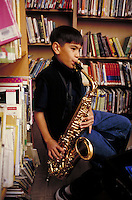 ELEMENTARY SCHOOL BAND PRACTICE  - BOY PLAYING SAXOPHONE. ELEMENTARY SCHOOL STUDENTS. OAKLAND CALIFORNIA USA CARL MUNCK ELEMENTARY SCHOOL.
