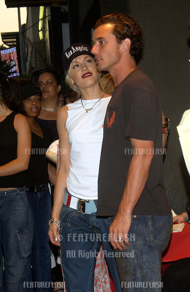 Singer GWEN STEFANI of No Doubt & husband singer GAVIN ROSSDALE at concert by Duran Duran at The Roxy in Los Angeles where they were performing in their first US concert in 18 years. .July 15, 2003