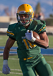 Bishop Manogue Miners  Peyton Dixon (10) runs against the Arbor View Aggies in the first half of their NIAA 4A State Semi-Final football game played at McQueen High School on Saturday, Nov. 24,2018.